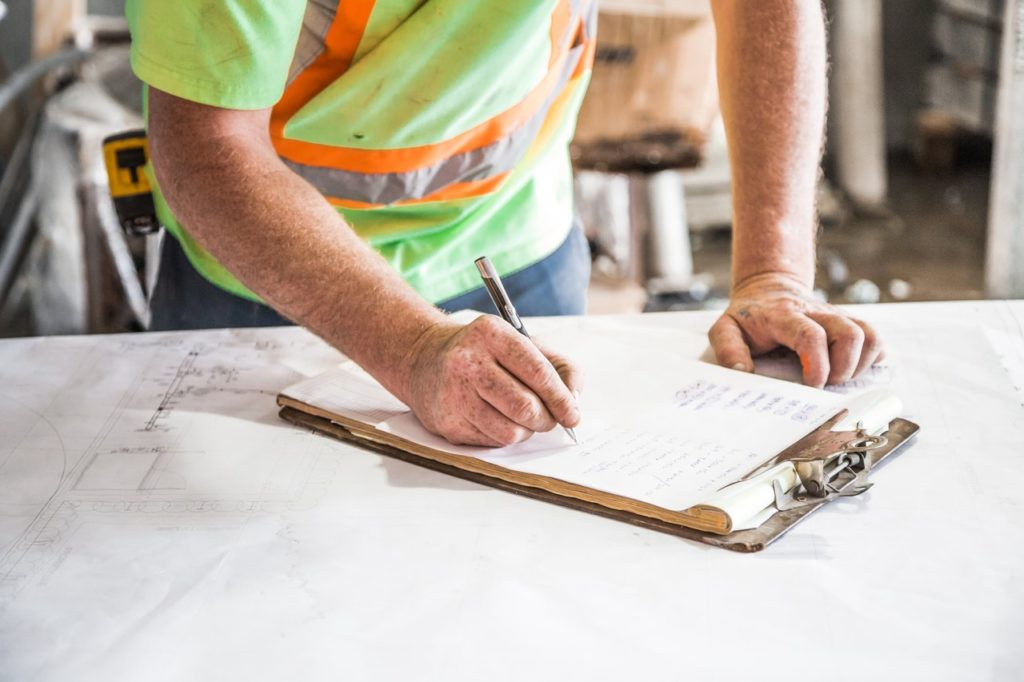 construction professional using clipboard