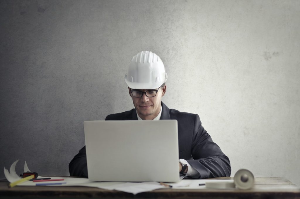 construction professional at laptop